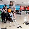 Don Knight | The Herald Bulletin<br /> Devin Morris helps Angel McCarter bowl during an outing to Championship Lanes on Thursday.