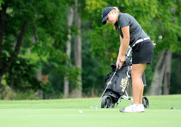 Don Knight | The Herald Bulletin<br /> Kristen Hobbs putts on the first green at Walnut Creek Golf Course during the Madison County Golf Tournament on Saturday.
