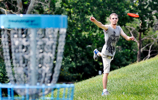 John P. Cleary | The Herald Bulletin Robert Frepan, of Anderson, takes aim at his target as he gets a round of disc golf in Monday afternoon at the Sanders Memorial disc golf course at Edgewater Park.