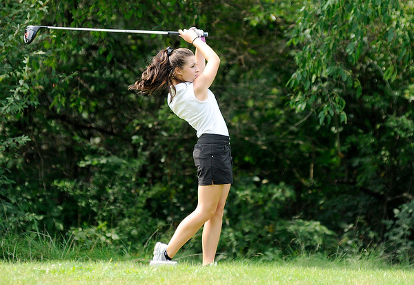 Don Knight | The Herald Bulletin<br /> Pendleton Heights' Grace Wiggins watches her drive of the second tee at Walnut Creek Golf Course during the Madison County Golf Tournament on Saturday.