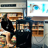 John P. Cleary | The Herald Bulletin<br /> Second-grader Gabrielle Wise, 7, and Alexandria-Monroe Elementary School nurse Brittney Gideon talk to the nurse at the Jane Pauley Center during a demonstration Tuesday of the school's new telehealth clinic. Gideon had taken a photo of Wise's eye for the nurse to see and is visible on the screen.