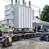 John P. Cleary | The Herald Bulletin<br /> Workers from G&L Movers slowly inch this 120,000 pound transformer onto a trailer Monday afternoon at Anderson Municipal Light & Power's 32nd Street substation in preparation to move it Tuesday morning to the city's 53rd Street substation.