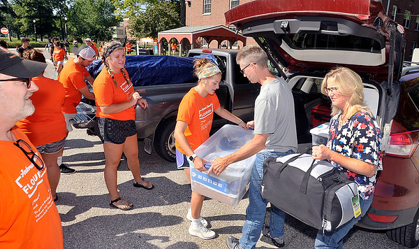 John P. Cleary | The Herald Bulletin<br /> Anderson University volunteers lineup to help unload vehicles on move-in day for incoming freshman Thursday at Dunn Hall.