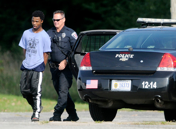 Don Knight   The Herald Bulletin<br /> A person is taken into custody in the parking of the Wesley Free Methodist Church on Eighth Street following a search on Thursday.