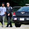 Don Knight | The Herald Bulletin<br /> A person is taken into custody in the parking of the Wesley Free Methodist Church on Eighth Street following a search on Thursday.