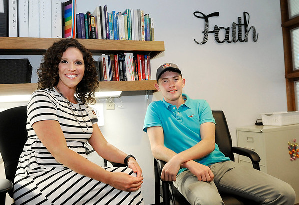 Don Knight | The Herald Bulletin<br /> Liam Rosencrans visits with Ashley Stangland at the Anderson Center. Liam graduated from the adolescent program at the Anderson Center where he learned to deal with anger issues.