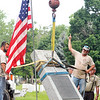 John P. Cleary | The Herald Bulletin<br /> Maplewood Cemetery had the American flags out for the relocation of the Anderson High School World War I monument as it was installed in the Veterans section of the Cemetery Monday morning.