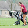 Don Knight | The Herald Bulletin<br /> Alexandria's Kelsey Rhodes chips from the fringe on the fourth hole at Yule Golf Course as the Tigers hosted Elwood on Wednesday.