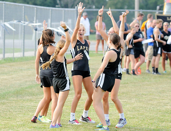 Don Knight   The Herald Bulletin<br /> The Lapel Bulldogs break their huddle on their run out before the start of the  2018 Aaron L. Stephenson Memorial Cross Country Invitational at Lapel on Tuesday. Read about the results in today's Sports section.