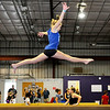 Don Knight | The Herald Bulletin<br /> Zoe Stachler, 12, practices on a balance beam during an open gym that was part of MEKS Gymnastics Academy's grand opening at their location at 1735 West 53rd Street Building 6 on Saturday.