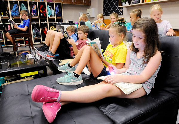 Don Knight   The Herald Bulletin<br /> From right, Claire Nicolai and Abigail Oster read during flashlight reading time in Melisa Merz's third grade class at East Elementary on Friday.