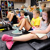 Don Knight | The Herald Bulletin<br /> From right, Claire Nicolai and Abigail Oster read during flashlight reading time in Melisa Merz's third grade class at East Elementary on Friday.