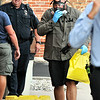 John P. Cleary   The Herald Bulletin<br /> Two APD officers were packaging evidence and was exposed to an unknown substance. Hazmat was called in. Here an officer brings out a bag containing the unknown substance wearing a breathing mask and gloves to secure in a spill kit outside of APD.