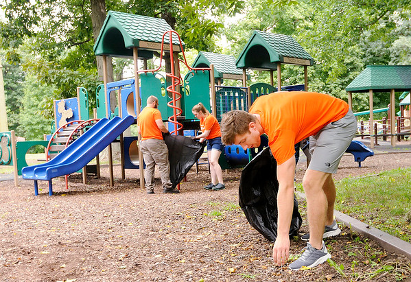 Don Knight   The Herald Bulletin<br /> Anderson University Freshman Isaac Atherton picks up trash from around Shadyside park on Friday. Incoming AU students fanned out across the park picking up trash as part of the First Year Experience.