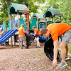 Don Knight | The Herald Bulletin<br /> Anderson University Freshman Isaac Atherton picks up trash from around Shadyside park on Friday. Incoming AU students fanned out across the park picking up trash as part of the First Year Experience.