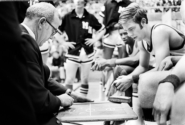 THB FILE PHOTO<br /> Madison Heights basketball coach Phil Buck draws up a play during a timeout as his son Joe looking on in 1975.