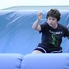 Don Knight | The Herald Bulletin<br /> Jeremiah Garza runs through an inflatable obstacle course at Hoosier Park on Friday. Hoosier Park celebrated the 25th running of the Dan Patch on Friday.