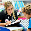 John P. Cleary | The Herald Bulletin<br /> Daleville Elementary School second grade teacher Jensen Hochstetler works with one of her students on a reading exercise the first week of school.  Hochstetler worked as an instructional assistant in the school library last year.