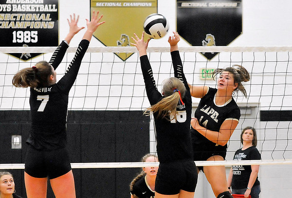 John P. Cleary   The Herald Bulletin<br /> Lapel's no.14, Emily Eppert, right, hits the ball between Daleville defenders, Ellie Halbert and Amabella Ray.