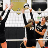 John P. Cleary | The Herald Bulletin<br /> Lapel's no.14, Emily Eppert, right, hits the ball between Daleville defenders, Ellie Halbert and Amabella Ray.