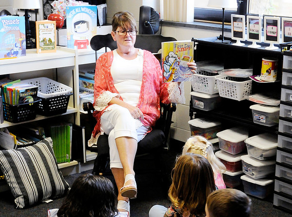 "Don Knight | The Herald Bulletin<br /> Vicky Hartley reads the book ""First Day Jitters"" to her second grade students on the first day of the new school year for Shenandoah students on Thursday."