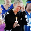 Don Knight | The Herald Bulletin<br /> Tina Nelson shares her memories of David L. Phillips II during a vigil for him at Walnut Park on Wednesday.