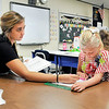 John P. Cleary | The Herald Bulletin<br /> Daleville Elementary School second grade teacher Jensen Hochstetler works with one of her students on a reading exercise the first week of school.