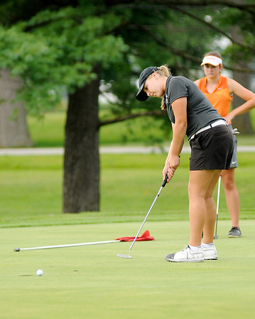 Don Knight | The Herald Bulletin<br /> Lapel's Kristen Hobbs putts on the second green during the Bulldog Invitational at the Edgewood Golf Course on Saturday.