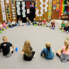 Don Knight | The Herald Bulletin<br /> Music teacher Heather Walton and her class sing a song using cups for percussion at East Elementary on Friday.