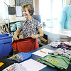 Don Knight | The Herald Bulletin<br /> Pam Jones inventories a tote of donations at Outfitters in Pendleton. Outfitters provides clothing to low-income, school-aged children throughout Madison County.