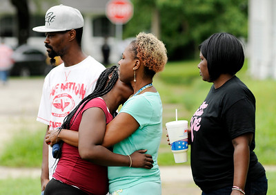 Don Knight | The Herald Bulletin Grieving family and friends console each other at the scene of a fatal shooting in Anderson on Friday.