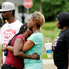 Don Knight | The Herald Bulletin<br /> Grieving family and friends console each other at the scene of a fatal shooting in Anderson on Friday.