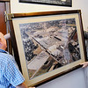 Don Knight | The Herald Bulletin<br /> From left, Corval Zeabart and Roger Hensley hank a photograph of the former Guide plant at The Madison County Historical Society. The Society has asked the county for $15,000 to help pay utility expenses.
