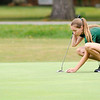 Don Knight | The Herald Bulletin<br /> Pendleton Heights' Kaylee McKenney places her ball on the second green before putting at the Lapel Invitational at the Edgewood Golf Course on Saturday.
