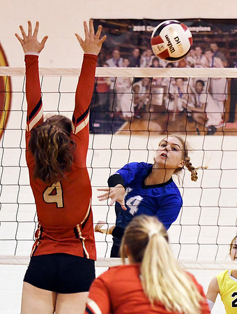 John P. Cleary | The Herald Bulletin<br /> APA's #14, Savannah Prewett, hits the ball just past Liberty Christian's Mady Rees, #4.