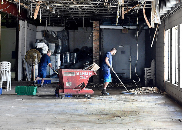 John P. Cleary | The Herald Bulletin Workers cleanup an area of the former Pay Less building as Barnett Bates, an Illinois company, as purchased the 34,500-square-foot  building at 2310 Broadway where the business plans to move its business operations.