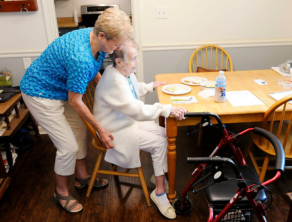 Don Knight | The Herald Bulletin<br /> Nancy Buckner helps Virginia Close sit down to lunch. In-home care allows Close to stay with family instead in a nursing home.