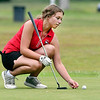 John P. Cleary | The Herald Bulletin<br /> Frankton's Sydney Dillman picks up her marker as she prepares to putt on #3 green at Yule Golf Club Monday during their match with Wes-Del and Alexandria.