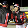 Don Knight | The Herald Bulletin<br /> Trainer Clyde Francis, left, congratulates driver Montrell Teague after he won the Dan Patch Stakes with Lather Up at Harrah's Hoosier Park on Friday.