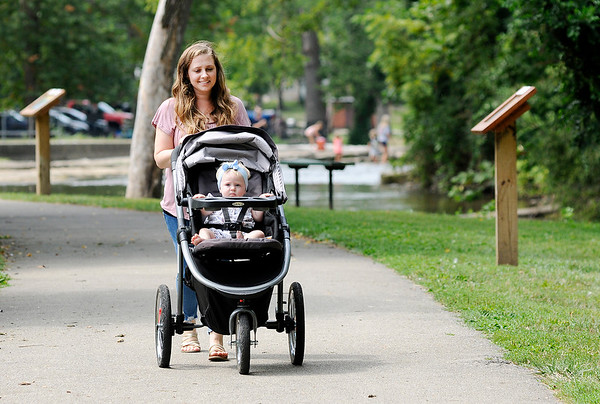 Don Knight | The Herald Bulletin<br /> Mary Jones pushes her daughter Emersyn in a stroller while out for a walk at Falls Park in Pendleton on Friday.