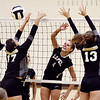 John P. Cleary | The Herald Bulletin<br /> Lapel's Zoe Freer, center, gets one of her kills against Daleville defenders Audrey Voss and Kadence Linn.