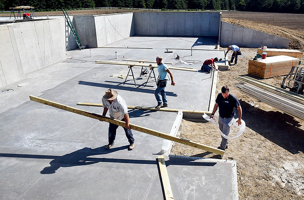 John P. Cleary | The Herald Bulletin<br /> Builder Chad Lukens, front right, and his crew, prepare the foundation of this new home for framing. The new construction is being built in southwestern Madison County.