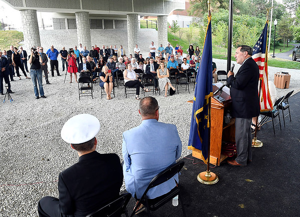 John P. Cleary | The Herald Bulletin<br /> Former U.S. Senator Joe Donnelly speaks at the dedication of the new Dwight D. Eisenhower Veteran's Memorial Bridge Thursday.  Local and national officials gathered under the bridge for the dedication ceremony of the new span over White River.