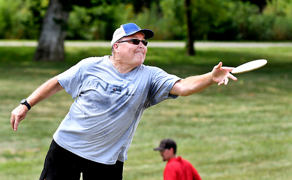 John P. Cleary | The Herald Bulletin<br /> Lee Whitman puts a little extra effort into his shot as he lets the disc fly while playing disc golf at the Sanders Memorial Disc Golf Course at Edgewater Park Thursday.