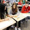 Don Knight | The Herald Bulletin<br /> From left, Makailyn Stewart, Taylor Beatrice and Ethan Krick play a order of operation game in Deanna House's Algebra II class at Anderson High School on Friday.