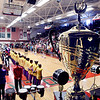 John P. Cleary | The Herald Bulletin<br /> The State Fair Championship trophy sits on stage as the members of the Anderson High School Marching Highlanders are introduced during a pep session Monday at the school to honor the band after their Band Day win Friday.