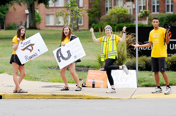 Don Knight | The Herald Bulletin<br /> From left, Elli Brooks, Claire Gabel, Megan Moran and Malik Laffoon welcome new students to campus on move-in day at Anderson University on Thursday.