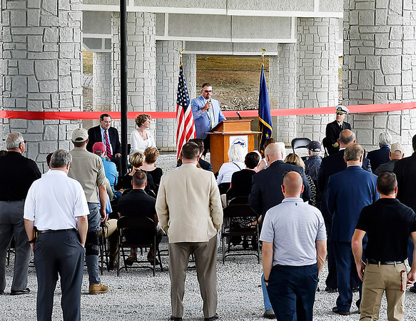 John P. Cleary | The Herald Bulletin<br /> Madison County Commissioner John Richwine addresses those gathered for the official dedication of the new Dwight D. Eisenhower Veteran's Memorial Bridge Thursday.