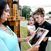 John P. Cleary | The Herald Bulletin<br /> Brandy Neff at the scene of where her son, Chase Kumkoski got killed on his motorcycle at 25th and Raible Ave, with his 18-month daughter Briar Kumkoski and his girlfriend Aspen Walker.