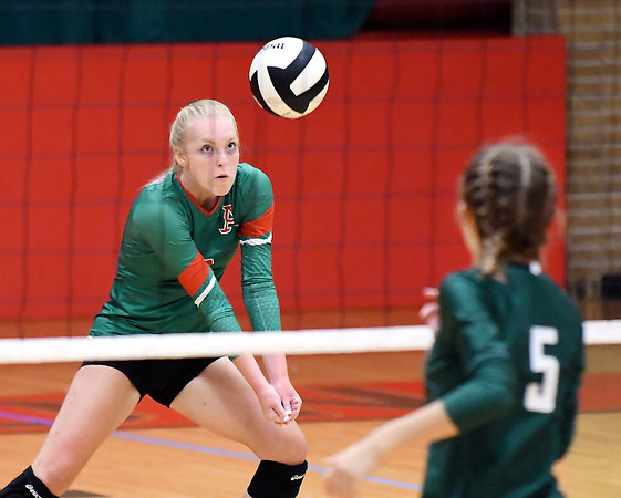John P. Cleary   The Herald Bulletin<br /> Anderson's Lexi Swanson watches the ball as she plays a serve during their match with Pendleton Heights.